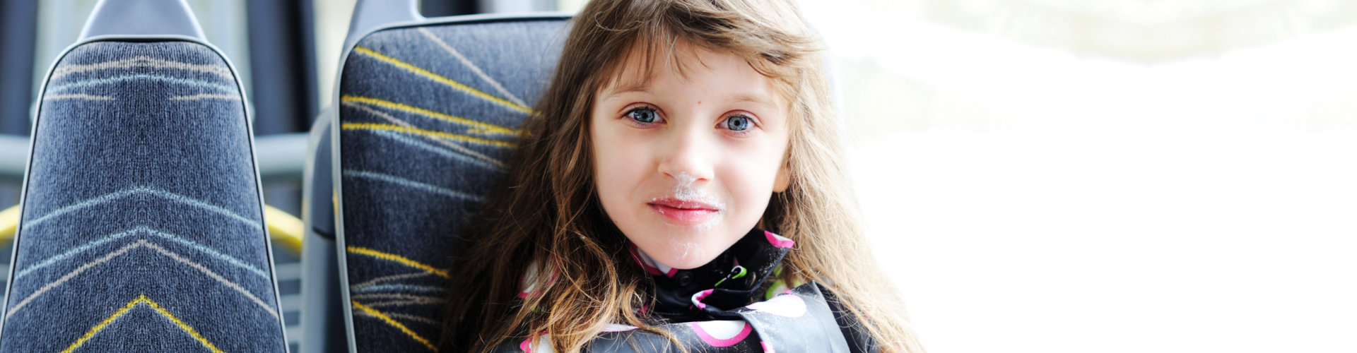 young girl sitting in the bus